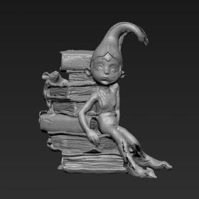 坐书堆上的高帽男孩